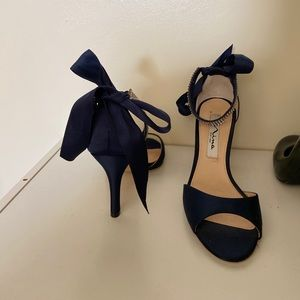 Navy blue heels that tie on the ankle